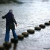 woman-stepping-stones-facebook